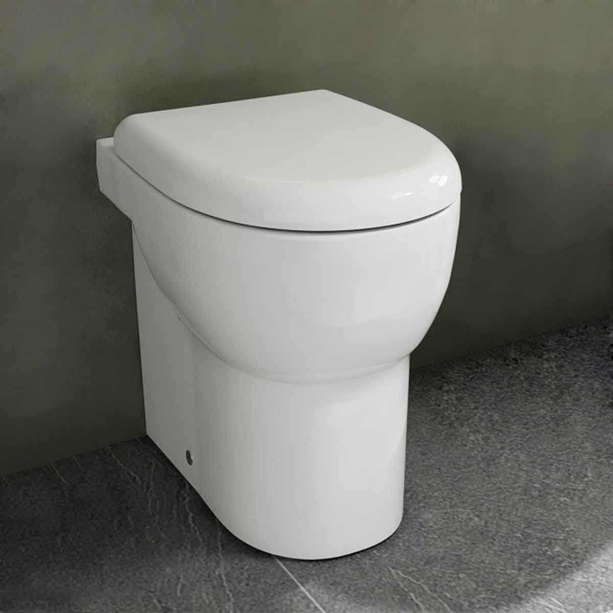 Wc filo parete  senza brida azzurra absolute con sedile soft close in termoindurente