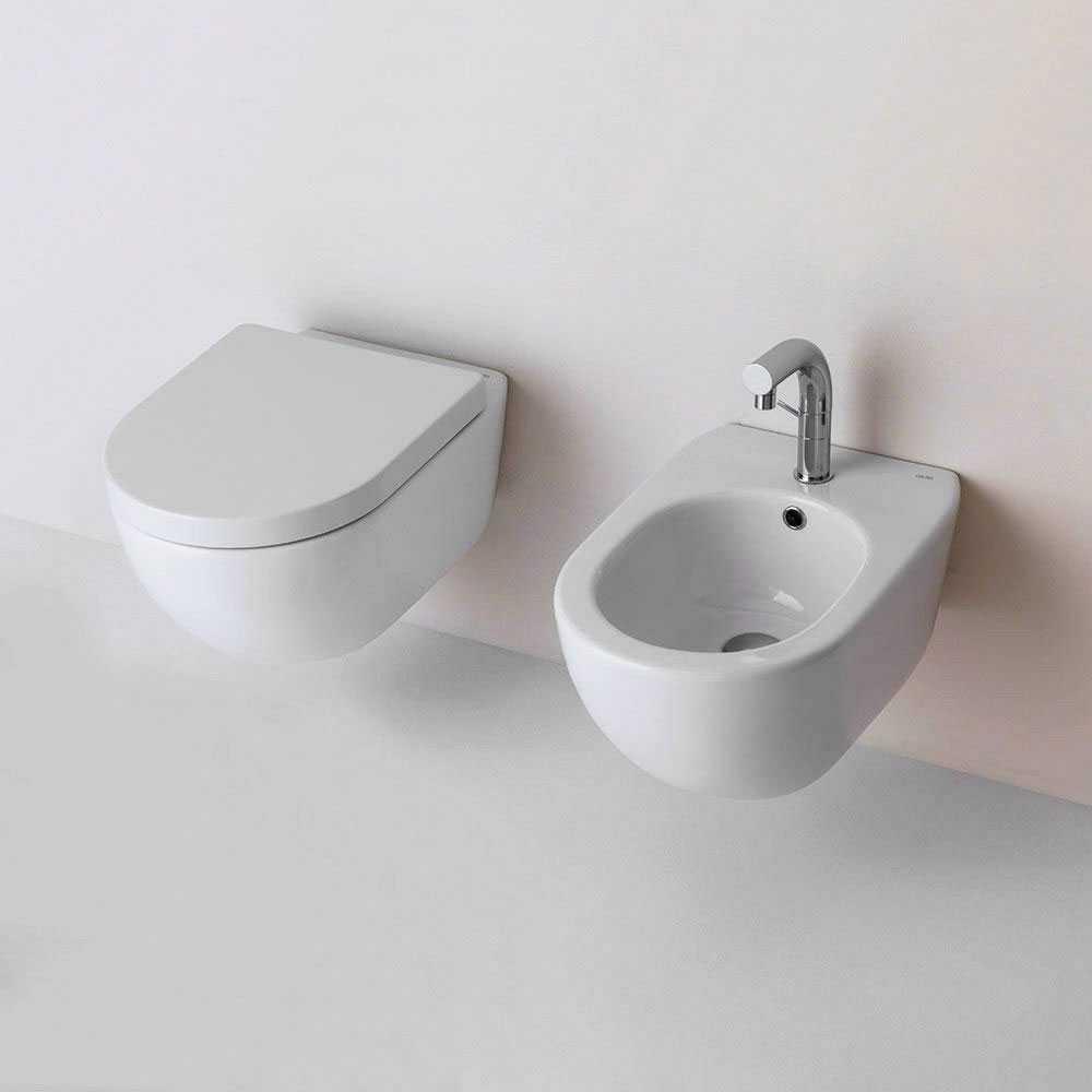 Sanitari sospesi senza brida Althea Cover in ceramica bianca wc+ bidet + sedile soft close slim